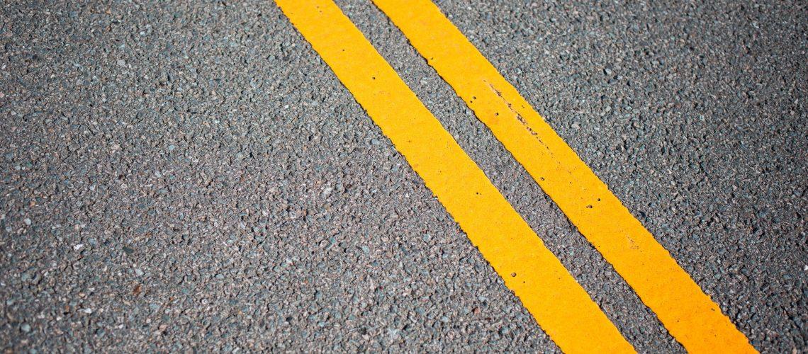 asphalt-road-with-yellow-road-lines-picjumbo-com